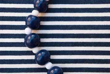 Jewellery Beads Aquamarine and white on striped fabric. Blue Line. Denim, sea.Handmade jewellery of polymer clay.