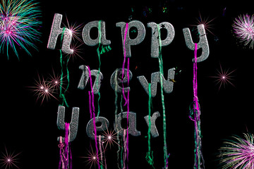 Happy new year party. Sliver glitter text with fireworks. Greeting card image.