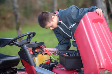Mechanic working on engine of mower