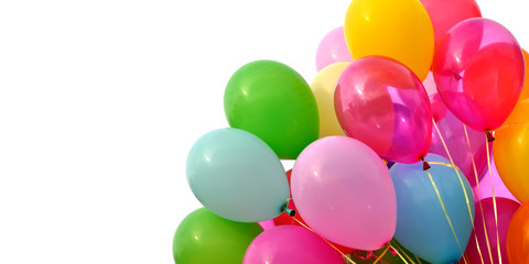 bunch of multicolored balloons, isolated on white background, banner format