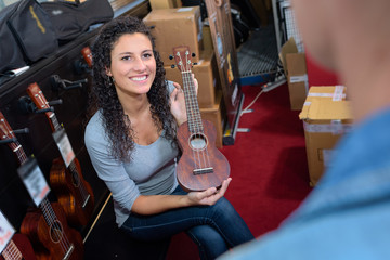 showing the ukulele