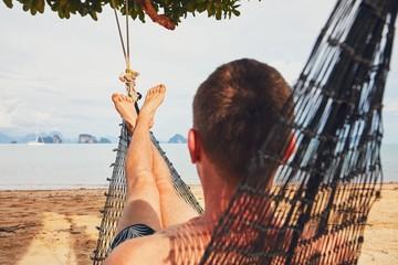 Man relaxing in the hammock