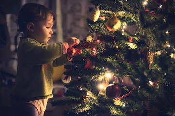 Baby lis hanging decoration on a Christmas tree