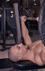 one bodybuilder, head and shoulders shot, close up, Bench Press, weights bar.