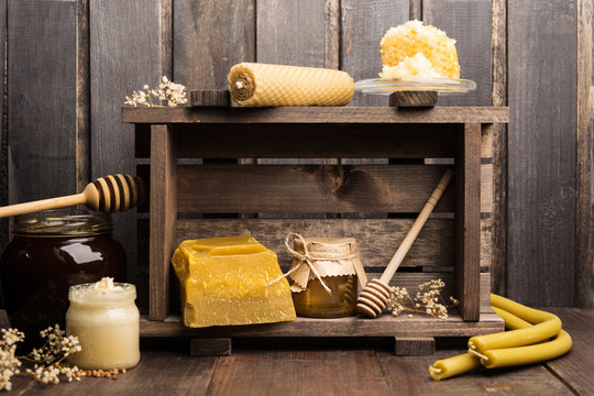 Still life of apicultural products with wax, candles and honey
