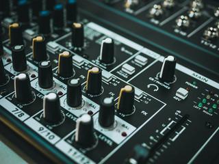 Professional audio equipment for sound recording studio faders volume regulators on midi piano