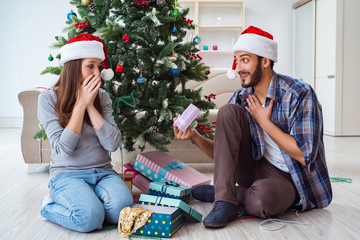 Girlfriend and boyfriend opening christmas gifts
