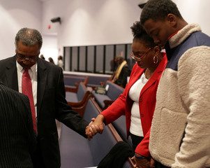 Members of the Progressive Union Missionary Baptist Church hold hands as they pray after listening to Democratic Alabama U.S. Senate candidate Doug Jones at the Progressive Union Missionary Baptist Church in Huntsville