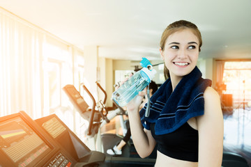 beautiful and smart healthy caucasian young woman smile while workout at gym fitness center with blur background