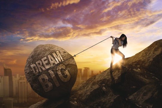 Female entrepreneur dragging text of dream big