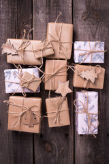 Gift boxes with presents on aged  wooden background.