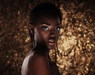 Obraz portrait of sensual young african woman against golden background - fototapety do salonu