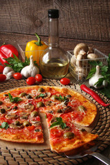 Pizza with tomatoes, mushrooms, black olives, Parmesan cheese, capers