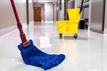 Mopping wet floor in hallway