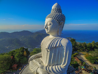 scenery blue sky and blue ocean are on the back of Phuket Big Buddha statue on the top of mountain.