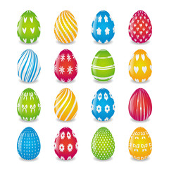 set of eggs painted in  yellow, blue, red and green colors with white patterns