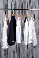 Pajamas on a metal rack in the shop. Hand-crafted sleeping garments for girls and boys. Kids clothing.