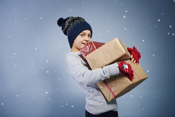 Side view of boy holding christmas gift