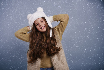 Portrait of cheerful girl at studio shot