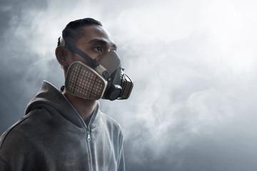 Graffiti artist wearing a gas mask