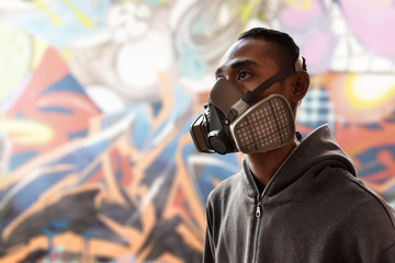 Graffiti artist wearing a gas mask