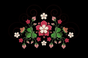 Embroidered pattern bouquet of red with white flowers and clover leaves on black background