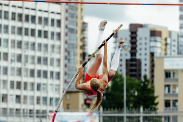 woman vaulter jump on competition in pole vault