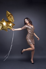 Cheerful woman with balloon at studio shot