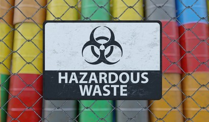 Hazardous waste sign on chain link fence. Oil barrels in background. 3D rendered illustration.