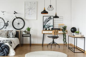 Wooden workspace in floral bedroom