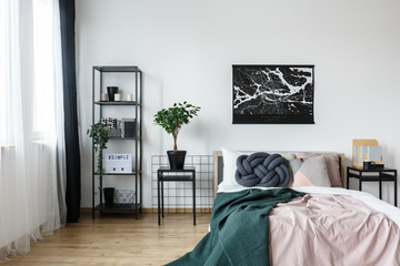 Poster over pastel pink bed