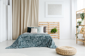Bed with patterned blue coverlet