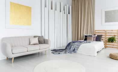 Grey couch in bedroom