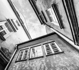 bottom view colorful houses in the center of Warsaw. Photo in black and white
