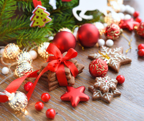 Christmas cookies with festive decorations on a wooden table