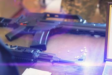 sub machine gun on the table in the interior gunsmith.