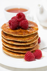 stack of pancakes with raspberries for breakfast, vertical closeup