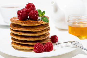 stack of pancakes with raspberries for breakfast