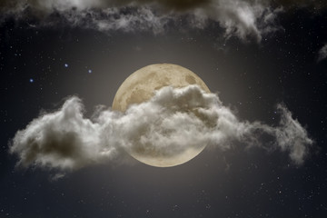 Strong cloud covering a full moon at night