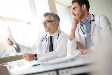 Doctors in office working on medical report