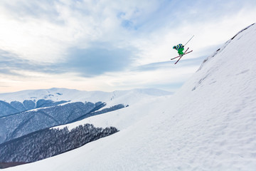 Fototapete - A skier is jumping from the cliff.