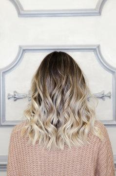 Beautiful female with balayage hairstyle back view