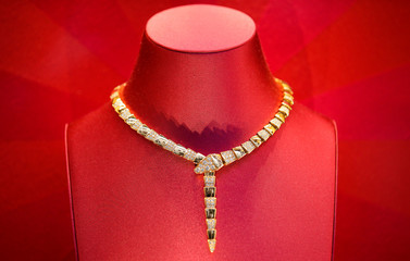 A Bulgari gold necklace is seen in a shop in downtown Rome