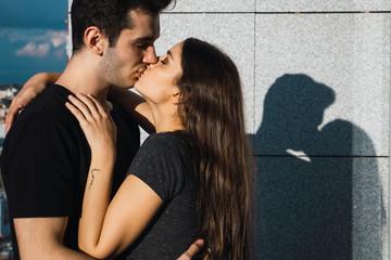 Couple kissing on balcony