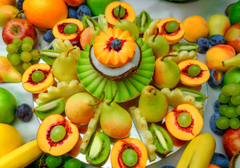 Colorful Fruit mix on the table. Decorated fruit table.