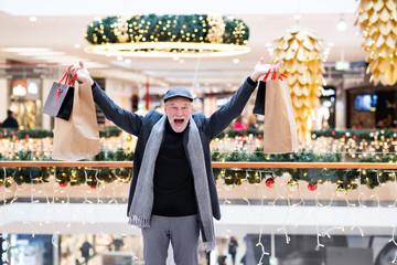 Senior man doing Christmas shopping.
