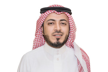 Portrait of young Saudi man have a beard wearing the Arab traditional uniform, red Shammagh and headband with white dress