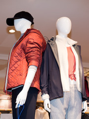 Mannequins men to present clothes in the showcase