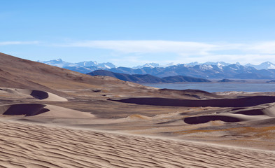 Panorama of Brahmaputra river, sand dunes and Himalayas along China-Nepal Border, Western Tibet, China