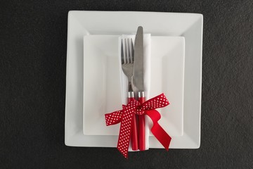 Table setting with square plates and cutlery